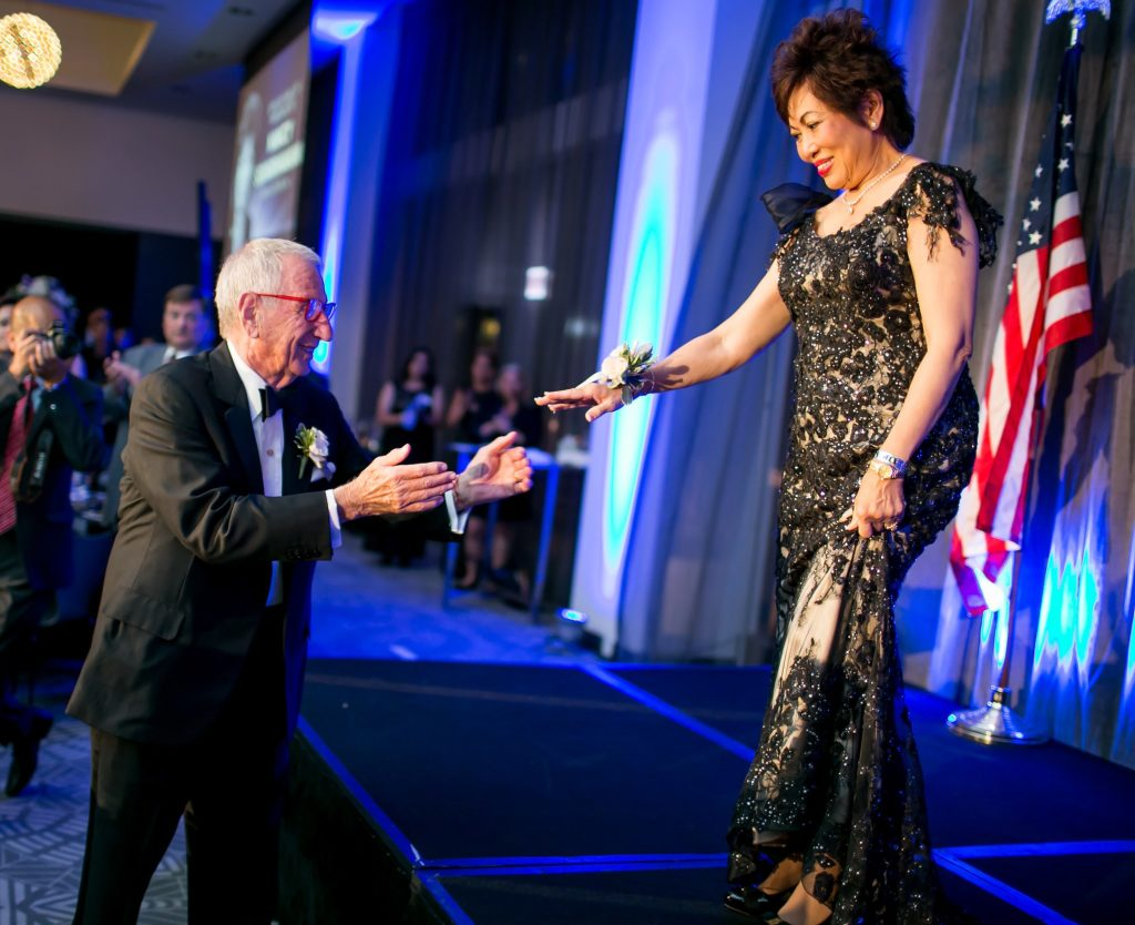 Sheldon Good takes the hand of Nancy Suvarnamani on the night of the Gala.